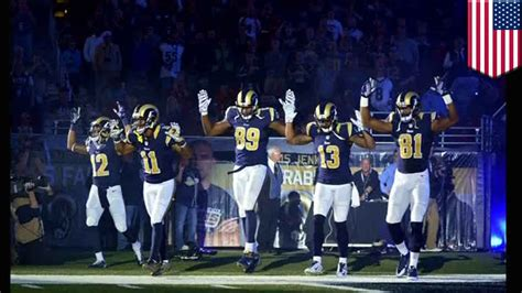 St Louis Rams show 'Hands up, don't shoot' to protest the